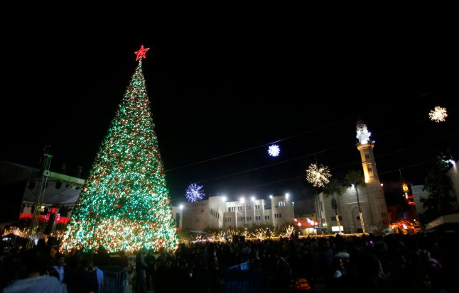 Christmas tree stands in the courtyard of the Nativity Church in the West Bank town of Bethlehem after the lighting ceremony