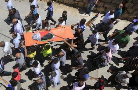 Mourners carry the body of 18-month-old Palestinian baby Ali Dawabsheh, who was killed after his family's house was set to fire in a suspected attack by Jewish extremists in Duma village near the West Bank city of Nablus July 31, 2015.  REUTERS/Abed Omar Qusini